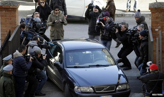 Members of the media surround Costa Concordia captain Francesco Schettino as he arrives at court - 11 February 2015