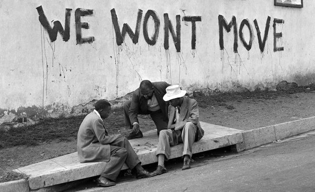 The slogan 'We Won't Move' appears on a wall in Sophiatown, a suburb of Johannesburg, 1955
