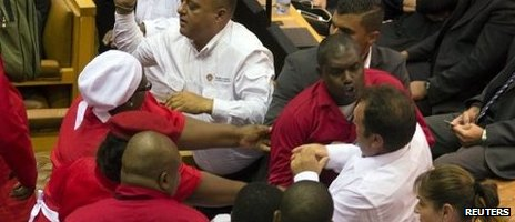 Red shirted EFF MPs brawl with white shirted security officers at South Africa's parliament