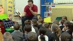 Man reading to schoolchildren