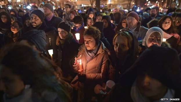 People take part in a vigil for three young Muslims killed in Chapel Hill, North Carolina, at Dupont Circle on February 12, 2015 in Washington, DC.
