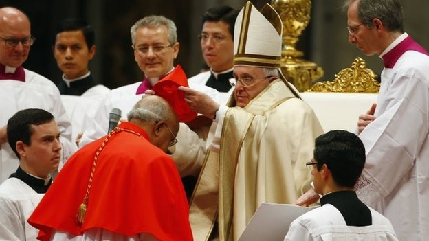 Pope Francis puts the hat on newly elevated Cardinal Berhaneyesus Demerew Souraphiel in St Peter's Basilica at the Vatican, 14 February 2015