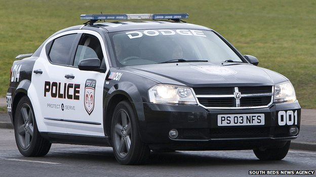 _81032103_sbna_policecarschoolrun11.jpg
