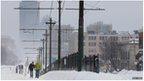 Pedestrians on snowy road in Boston