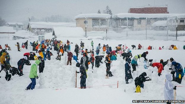People making snowmen at the festival