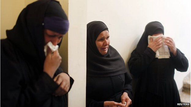 Women mourn the 21 Copts killed by IS