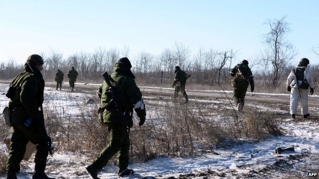 Pro-Russian rebels leave for a combat mission near the eastern Ukrainian city of Debaltseve, 17 Feb