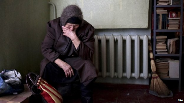 An elderly woman sits in the local Palace of Culture which is used as a bomb shelter in Mironovka village, near Debaltseve of Donetsk area, Ukraine, 17 February