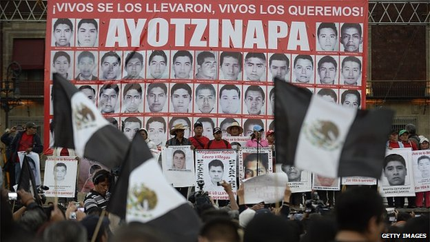People take part in a march commemorating four months of the disappearance of 43 students from Ayotzinapa, on January 26 at the Zocalo square in Mexico City.