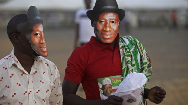 Supporters of Nigerian President Goodluck Jonathan, wear masks depicting his face during his visit in Yola, Nigeria, on 29 January 2015