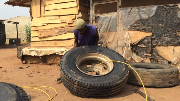 A tyre being pumped with air at Ogbere Trailer Park in Ogun state, Nigeria - February 2015