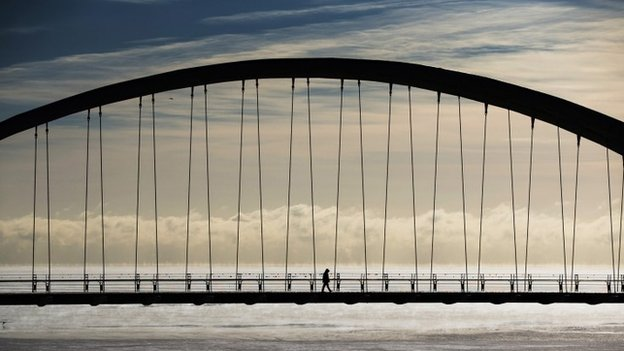 A person walks across the Humber Bay Arch Bridge during extreme cold temperatures in Toronto, February 16, 2015.