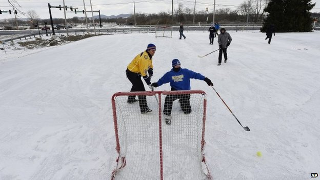 A group of boys play hockey on a frozen parking lot on 18 February in Brentwood, Tennessee