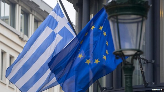 A Greek and a European flag flutter outside the Greek embassy in Brussels, 19 Feb