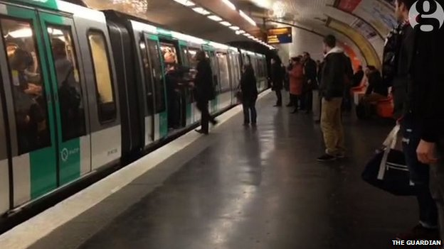 Image of a man being pushed off the metro in Paris