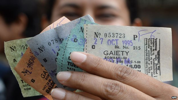 Woman holding tickets for Dilwale dating back to 1995