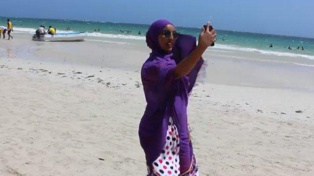 A woman taking a selfie on a beach