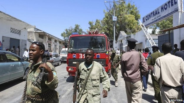 "Somali security agents are seen outside the Central Hotel after a suicide attack in Somalia""s capital Mogadishu February 20, 2015"
