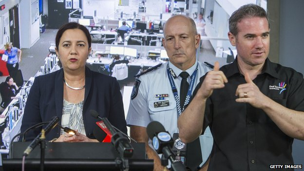 Queensland Premier Annastacia Palaszczuk speaks to the media along side the Queensland Police Service Deputy Commissioner Steve Gollschewski and Interpreter Mark Cave, aka #SignGuy