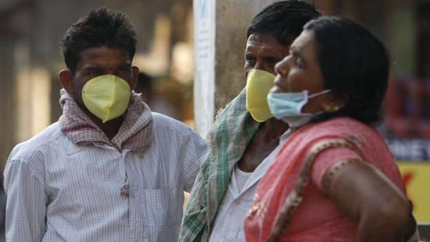 Indians cover their faces with masks as preventive measure against swine flu at the Gandhi Hospital in Hyderabad, Feb 20