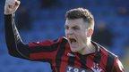 Crusaders striker Dairmuid O'Carroll celebrates scoring a penalty in the 7-3 win over Glenavon