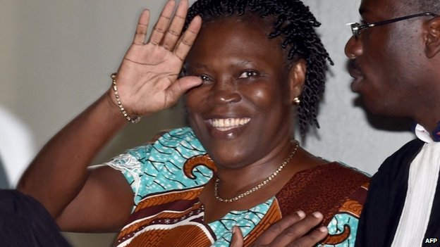 "Ivory Coast""s former first lady Simone Gbagbo waves as she arrives at the Court of Justice in Abidjan, on February 23, 2015"