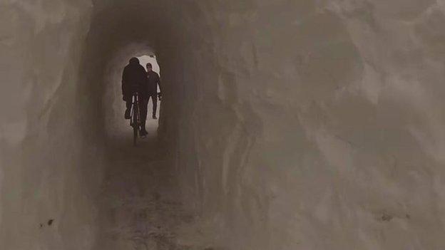 Cycling through snow tunnel