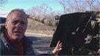 Paul Adams next to heavy weaponry near Donetsk