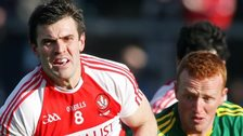 Mark Lynch of Derry in action against Kerry's Johnny Buckley