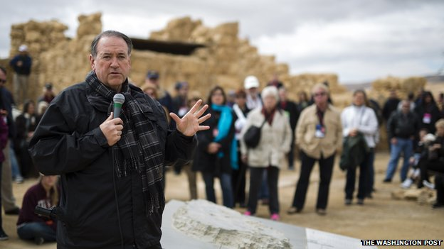 Mike Huckabee speaks to tourists in Israel.