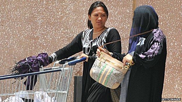 A Filipina maid and her Saudi employer
