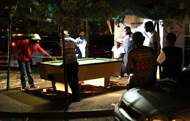 Playing pool in a car park