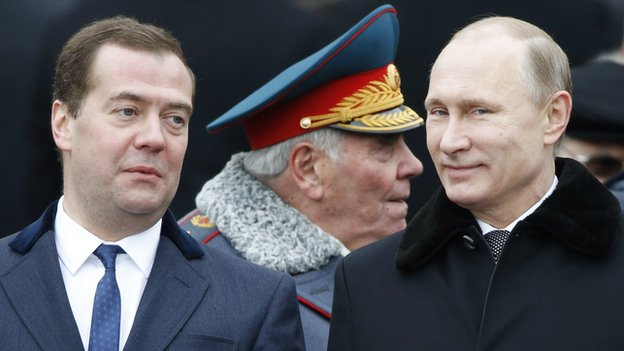 Russian President Vladimir Putin and Prime Minister Dmitry Medvedev at a a wreath-laying ceremony at the Tomb of the Unknown Soldier in Moscow on 23 February 2015.