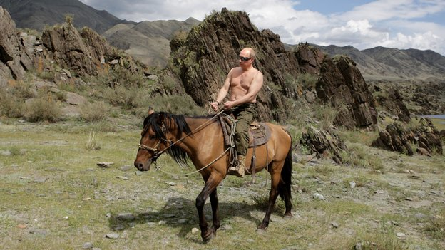 A bare-chested Russian Prime Minister Vladimir Putin rides a horse during his vacation outside the town of Kyzyl, in southern Siberia, on 3 August 2009.