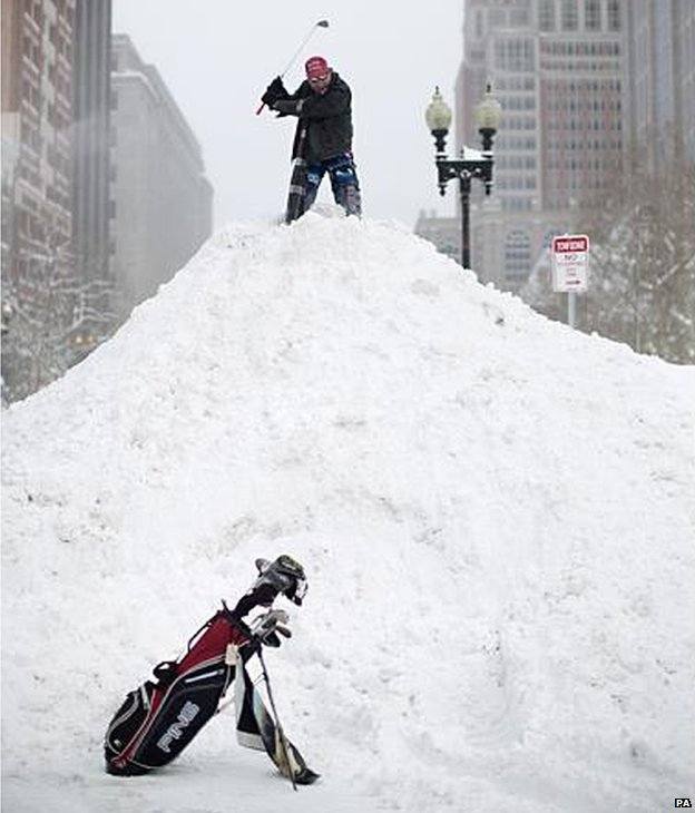 Playing golf on snow pile