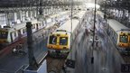 Commuters disembark from crowded suburban trains during the morning rush hour at Churchgate railway station in Mumbai December 5, 2012.