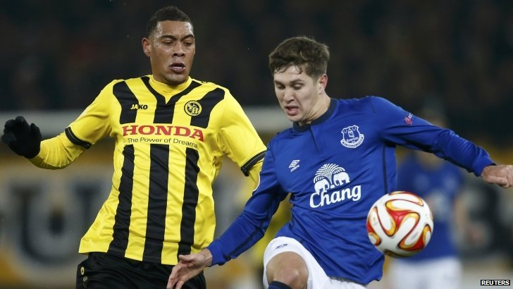 "BSC Young Boys Guillaume Hoarau (L) challenges Everton""s John Stones during the first leg of the Europa League clash"