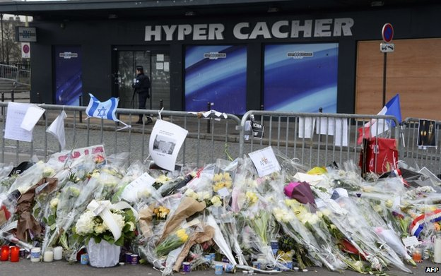 Flowers and tributes outside the Jewish supermarket attacked by gunman Amedy Coulibaly in January 2015