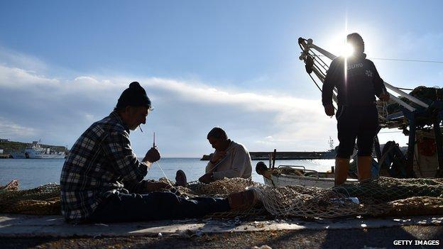 Lampedusa fisherman fixing their nets