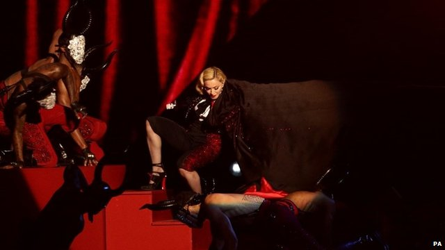 Madonna stumbles whilst performing on stage at the Brit Awards