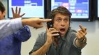 Stockbrokers shouting on the phone