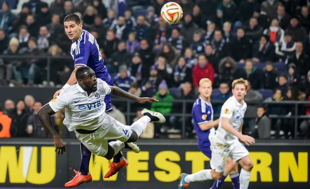 Anderlecht player Aleksandar Mitrovic, top left, challenges Dynamo Moscow player Christopher Samba 19 February 2015