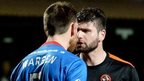 Inverness defender Gary Warren and Dundee United striker Nadir Ciftci square up at Tannadice