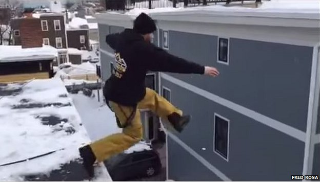 Man jumps off building into snow