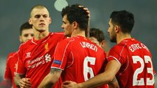 Dejan Lovren is consoled after his penalty miss