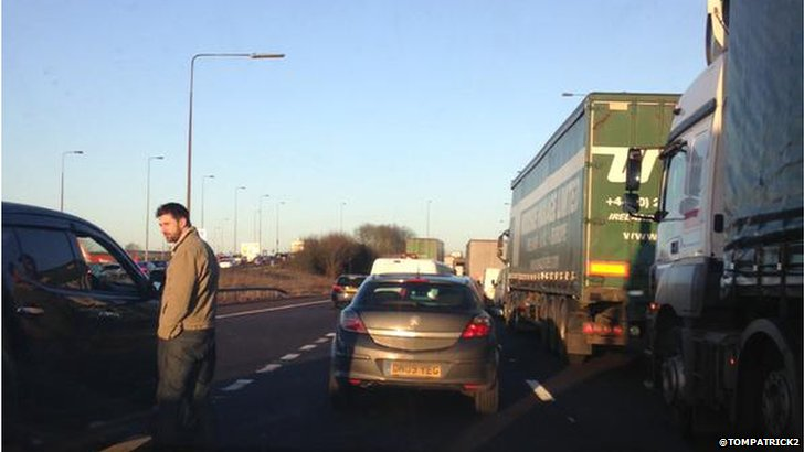 Driver walking on the carriageway