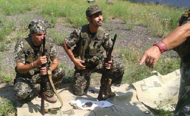 Picture published on Spanish Interior Ministry website apparently showing Spanish nationals fighting with weapons in Ukraine