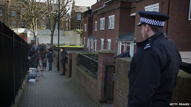 Police and TV crews outside an address in London where Emwazi is believed to have lived