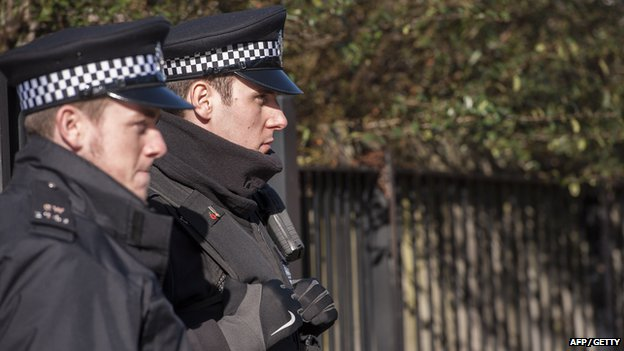 Police on patrol outside the property in London where Emwazi is thought to have lived