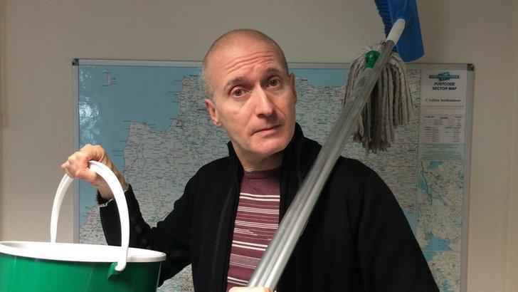 Bill Buckley with bucket and mop